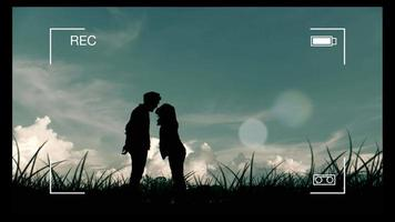 Silhouette with Parallax motion graphics of Couple kissing in the meadow