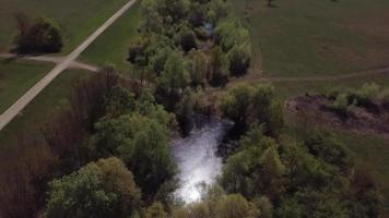 Drone flying above trees and water holes in 4k video