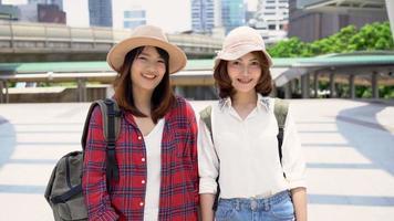 Traveler backpacker Asian women lesbian lgbt couple travel in Bangkok, Thailand.  video