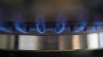 Natural gas inflammation in stove burner, close up view video