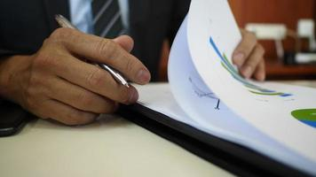 Businessman signing contract business documents.