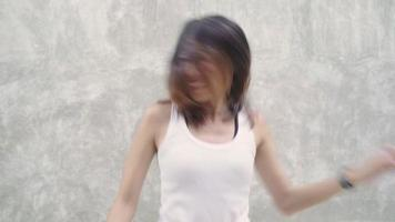 Slow motion - Cheerful beautiful young Asian backpacker blogger woman feeling happy dancing on street. video