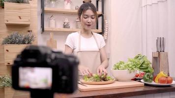 Female use organic vegetables preparing salad for fit body at home. video
