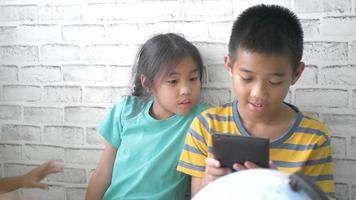 Children's using smart phone at home.	 video