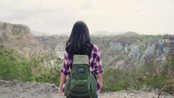 Slow motion - Hiker Asian backpacker woman walking to top of mountain. video