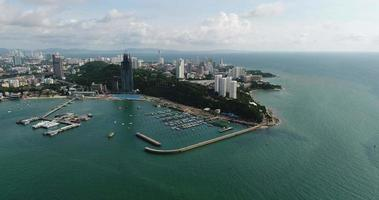 Aerial panoramic view of Pattaya Beach over crystal clear tropical water on island