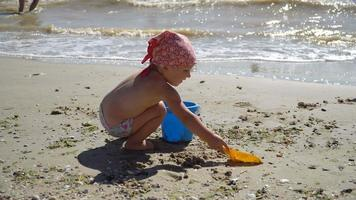 Child Playing with Sand at Beach