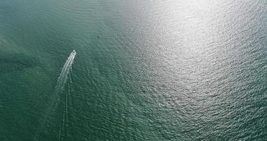 Aerial view of speed boats on the sea near beach city, Pattaya, Thailand.