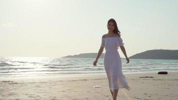 Young Asian woman walking on a beach