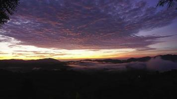 Sunrise over mountains and fog video