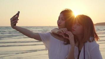 Young Asian friends taking a selfie on the beach
