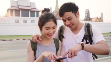 Couple using mobile phone to search a location video