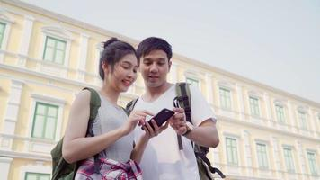 Couple using mobile phone to search a location