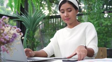 Young Asian woman working on laptop  video