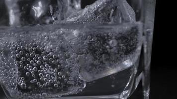 Close up pouring soft drink to glass with ice video