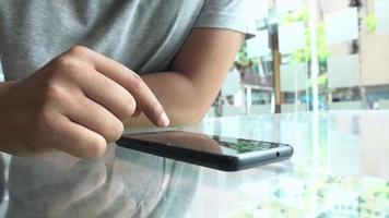 Young man using mobile phone video