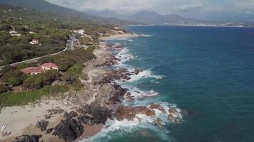 Drone flying over a coast with waves in 4K