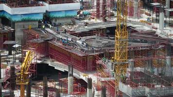 Crane over building under construction site