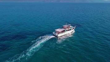 Drone follows a tourist boat in 4K