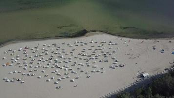 Aerial view on roofed wicker beach chairs