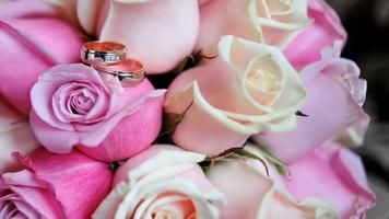 Two Gold Rings On A Bouquet