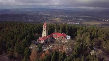 Drone orbiting a watch tower in 4K