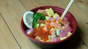 Shirashi Don Japanese food with chopsticks video