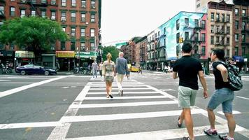 African American men walk across street in New York City video
