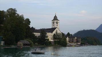 St. Wolfgang chapel and the village of St. Wolfgang at Wolfgangsee lake, Austria video