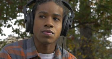 Young Man Listening to Music in Headphones video