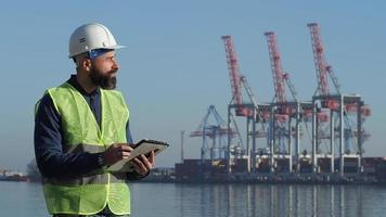 Port Worker Working With A Tablet video