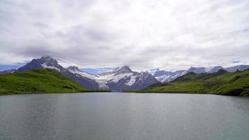 Bachalpsee lake with Swiss Alps in Grindelwald, Switzerland