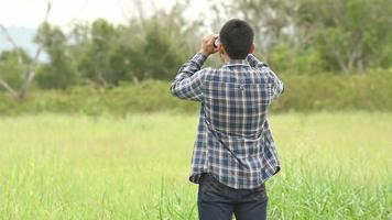 Man Looking Around with Binoculars