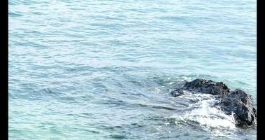 Black stone in the sea