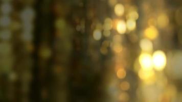 bokeh abstrait brillant et clignotant de paillettes dorées