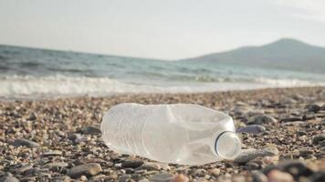 A Plastic Bottle Laying on the Beach
