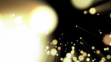 funkelnde goldglänzende Partikel aus einem Loch