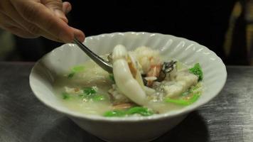 papilla de mariscos o arroz hervido con mariscos