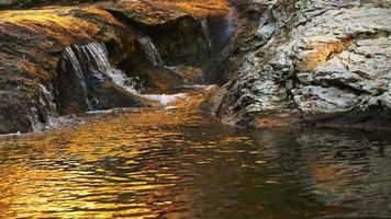 Waterfall With A Golden Sunlight