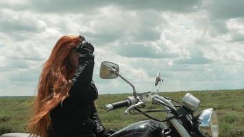 Biker Woman on Top of Grassy Hill