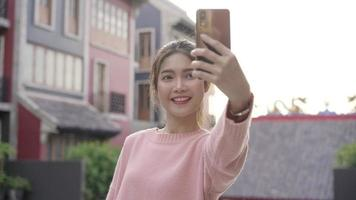 Young Asian woman taking a selfie while traveling in Beijing, China video
