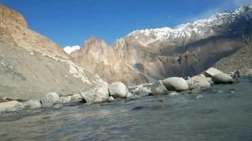 Flowing stream against Karakoram mountain range video