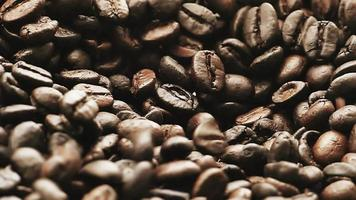Slow motion coffee beans smoothly dropping