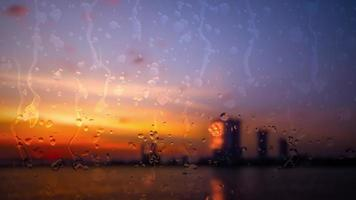Blurred City and river under the Rain during sunset Animation.
