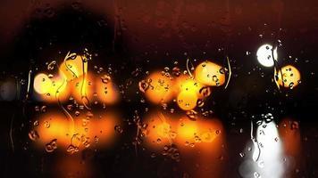 gotas de chuva em vidro com fundo desfocado de luzes. video