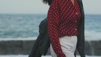 Asian girl walks at the beach