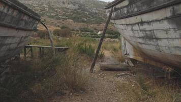 Old abandoned fishing boats put on land video