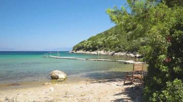 Wooden chairs at a beautiful beach in Samos, Greece.