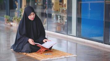 Muslim Woman Read the Book that Relate to Her God