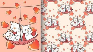 Adorables gatos dentro de una sombrilla roja con patrón de corazones